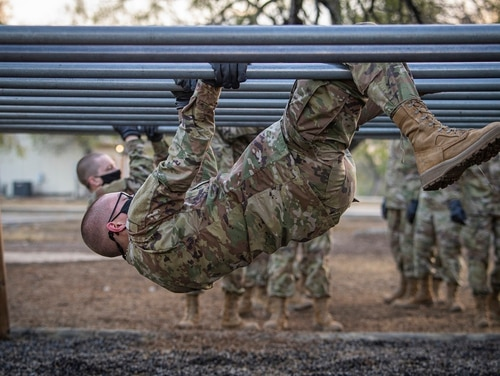 A Space Force trainee participates on the over-and-under bars obstacle during Basic Expeditionary Airman Skills Training at Joint Base San Antonio-Chapman Annex, Texas, Dec. 2, 2020. (Staff Sgt. James R. Crow/Air Force)