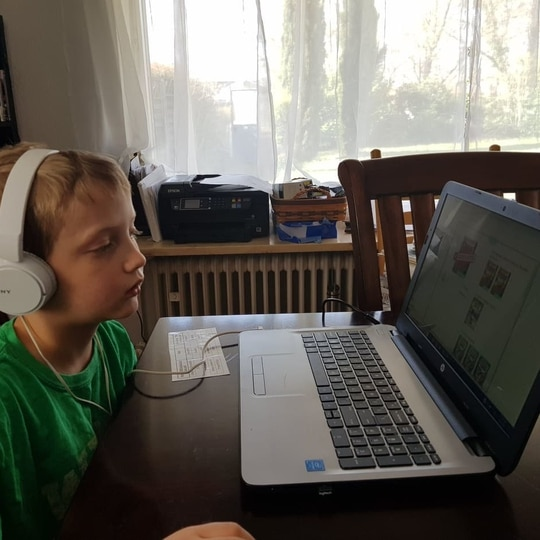 Irwin Wynn, second grader, completes an online lesson April 14, 2020, at U.S. Army Garrison Wiesbaden, as DoDEA students moved to remote learning. (Photo courtesy of Julie Wynn/via DVIDS)