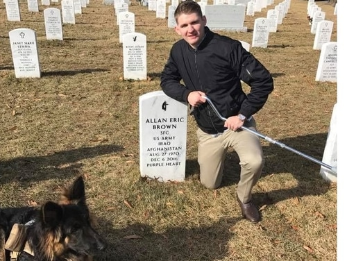 Spc. Winston Hencely visited the grave of a noncommissioned officer killed in a Nov. 12, 2016, attack on Bagram Airfield. Hencely, who was injured in the blast, is suing the insurgent's employer. (Photo courtesy Butler, Wooten and Peak)
