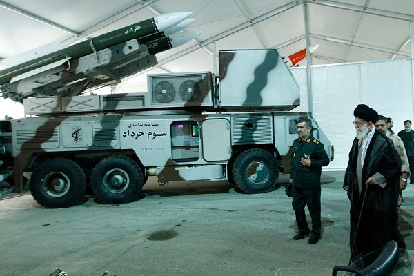Iran said it has used its air defense system known as Third of Khordad, seen here on May 11, 2014, to shoot down the drone — a truck-based missile system that can fire up to 18 miles (30 kilometers) into the sky. The commander of the Revolutionary Guard's aerospace division Gen. Amir Ali Hajizadeh, second right, accompanies Ayatollah Khamenei. (Office of the Iranian Supreme Leader via AP)