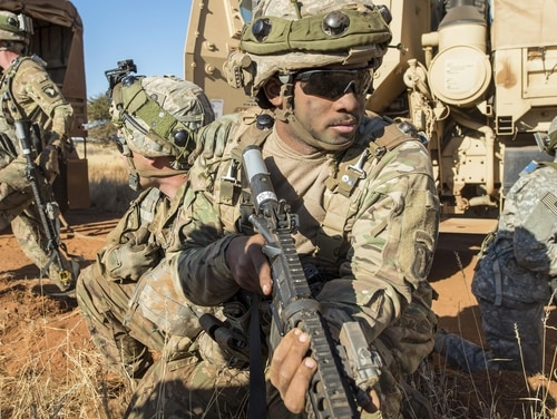 Pfc. Cameron Livingston, center, provides security as part of an attack scenario during the Shared Accord exercise at the South African Army Combat Training Center in Lohatla, South Africa, July 27. (Army)