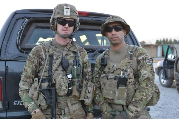 U.S. Army Sgt. Andrew Mahoney (left) of Laingsburg, Mich., with 1st Lt. Florent A. Groberg (right) serving on a personal security detail with the 4th Infantry Brigade Combat Team, 4th Inf. Div., during a deployment to Regional Command-East, Afghanistan. 9. Florent and SGT Mahoney posing in front of a PSD vehicle in Nangarhar Province, Afghanistan in July 2012.