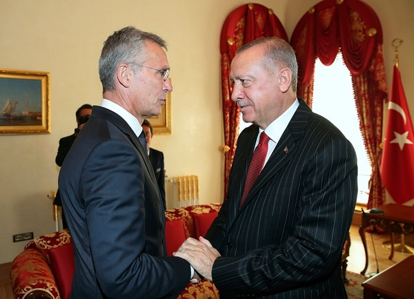 NATO Secretary General Jens Stoltenberg, left, with Turkey's President Recep Tayyip Erdogan before a meeting, in Istanbul, Friday, Oct. 11, 2019. (Presidential Press Service via AP, Pool)