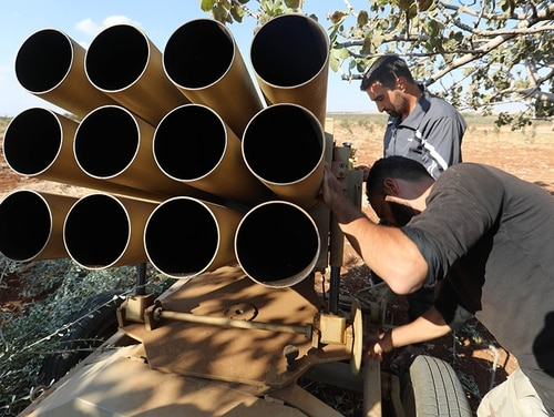 Syrian rebel fighters prepare weapons in the Syrian village of al-Zakat in the northern countryside of Hama province on Sept. 17, 2018. Residents of Idlib province and surrounding areas have been bracing themselves for a Russian-backed government offensive on the country's largest remaining rebel-held zone. (Omar Haj Kadour/AFP via Getty Images)