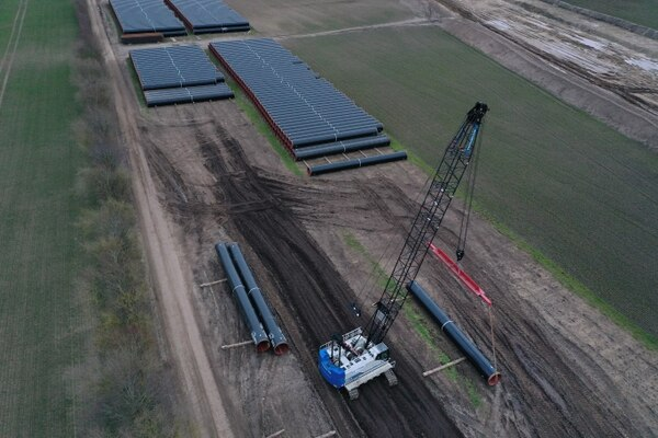 Sections of pipe lie at a pipe depot for construction of the Eugal gas pipeline on March 26, 2019, near Wrangelsburg, Germany. The pipeline is meant to transport natural gas arriving from Russia through the Nord Stream 2 pipeline. (Sean Gallup/Getty Images)