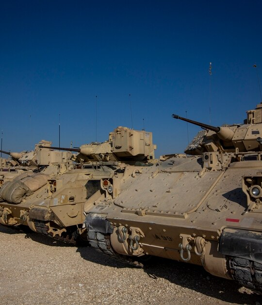 Bradley fighting vehicles are parked at a US military base at an undisclosed location in northeastern Syria, Nov. 11, 2019. (Darko Bandic/AP)