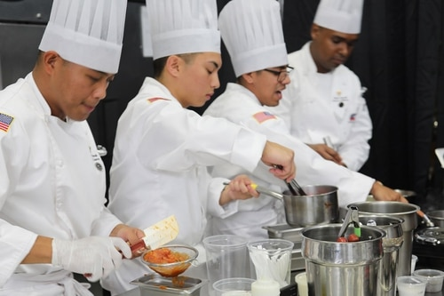 Team Hawaii culinary arts specialists prepare a three-course meal March 13 during the student team event at the Joint Culinary Training Exercise, Fort Lee, Virginia. (Dani Johnson/Combined Arms Support Command)