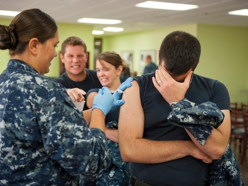 In this file photo, a Navy corpsman assigned to Naval Health Clinic Corpus Christ, administers an influenza vaccine to a patient. The facility is among those slated for changes under a new Pentagon plan to shift the mission of some military health facilities to caring for only active duty personnel (U.S. Navy photo by Bill W. Love/Released)