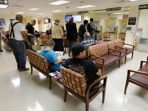 People line up to get prescriptions filled at the Sacramento Veterans Affairs Medical Center pharmacy in Rancho Cordova, Calif., in 2015. A new GAO report found lengthy wait times among veterans using the VA Choice program, which was designed to allow quicker medical appointments for those patients. (Rich Pedroncelli/AP)