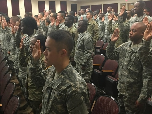 A lawmaker says changes to one of the military's immigrant-recruitment programs are necessary, but the services still require the skills of non-citizen troops. Here, soldiers become U.S. citizens at a naturalization ceremony held at Fort Lee, Virginia. (U.S. Citizenship and Immigration Services)