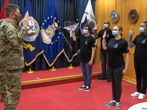 Vice Chief of Space Operations Gen. David Thompson swears in the first four enlisted recruits to the Space Force at Military Entrance Processing Station-Baltimore in Maryland, on Oct. 200. (Screenshot from Defense Department livestream)
