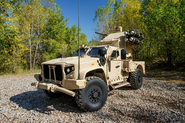 The military is purchasing 5,113 Joint Light Tactical Vehicles, such as Oshkosh Joint Light Tactical Vehicle it displayed at AUSA 2017 with an Avenger air defense launcher on the back. (Photo courtesy of Oshkosh)