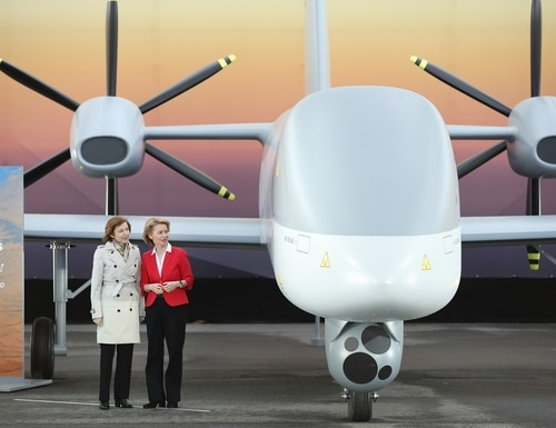 Then-German Defense Minister Ursula von der Leyen (R) and French Defense Minister Florence Parly stand next to a mockup of the European MALE UAV drone at the ILA Berlin Air Show on April 26, 2018, in Schoenefeld, Germany. (Photo by Sean Gallup/Getty Images)
