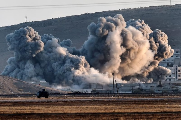 Smoke rises after airstrikes on the Syrian town of Ain al-Arab, known as Kobane by the Kurds in October 2014. The Pentagon warned at the time that U.S. air power on its own could not prevent Islamic State from advancing in the area. (Aris Messinis/AFP/Getty Images)