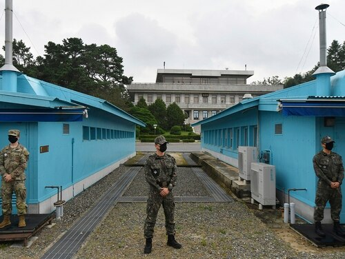 In this Sept. 16, 2020, file photo, U.S. and South Korean soldiers stand guard during South Korean Unification Minister Lee In-young's visit to Panmunjom in the Demilitarized Zone, South Korea. (Park Tae-hyun/Korea Pool via AP, File)