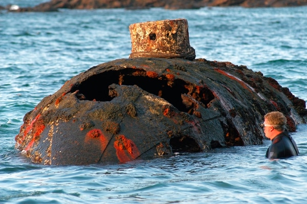 In this March 12, 2004 photo provided by the U.S. embassy in Panama, a diver stands by the submarine designed by Julius H. Kroehl, wrecked off San Telmo Island, Panama. (James Delgado/US Embassy in Panama via AP)