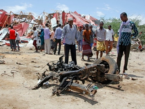 Somalis watch the wreckage of the car bomb after an attack on a European Union military convoy in the capital Mogadishu, Somalia Monday, Sept. 30, 2019. A Somali police officer says a suicide car bomber has targeted a European Union military convoy carrying Italian military trainers in the Somali capital Monday. (Farah Abdi Warsameh/AP)