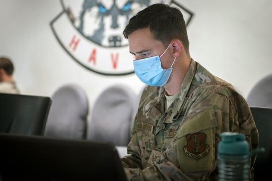Tech. Sgt. Bryan Dauphinais, 103rd Communications Flight cyber transport journeyman, analyzes simulated cyberattacks during exercise Cyber Yankee. (Staff Sgt. Steven Tucker/U.S. Air National Guard)
