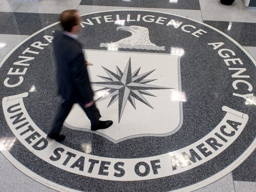 A man crosses the Central Intelligence Agency (CIA) logo in the lobby of CIA Headquarters in Langley, Virginia, on August 14, 2008.(SAUL LOEB/AFP/Getty Images)