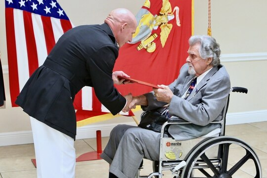 Marine Corps Col. John Polidoro, chief of staff, U.S. Marine Corps Forces Central Command, awards the Silver Star on Cpl. Salvatore Naimo, a Korean War Veteran in Sarasota, Florida, on March 17. (Gunnery Sgt. Eric Alabiso II/ Marine Corps)