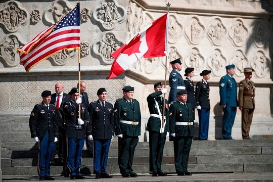 U.S. and Canadian flag bearers stand at attention outside the cathedral after a religious ceremony to mark the 100th anniversary of the World War I Battle of Amiens, at the Cathedral in Amiens, France, Aug. 8, 2018. (Benoit Tessier/AFP via Getty Images)