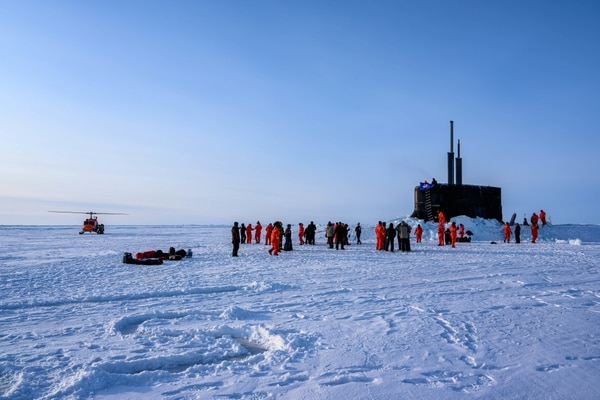 The crew of the U.S. Navy's Seawolf-class submarine Connecticut enjoys ice liberty after surfacing in the Arctic Circle during Ice Exercise 2020 on March 7, 2020. (MC1 Michael B. Zingaro/U.S. Navy)