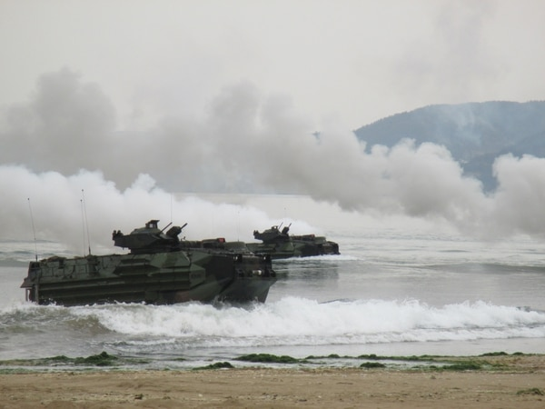 Marines aboard amphibious assault vehicles conduct a rehearsal combined forcible entry landing operation on Dogue beach March 29 in Pohang, Republic of Korea as part of exercise Ssang Yong 2014. Ssang Yong demonstrates the ROK-U.S. Navy and Marine Corps' responsive amphibious and expeditionary capabilities from the sea. Forward-deployed and forward-based U.S. Marine forces, in conjunction with U.S. allies, have the unique ability to provide rapid force deployment for the full range of military operations, specifically in the Pacific region. The Marines are with Company E, Battalion Landing Team 2nd Battalion, 5th Marines, 31st Marine Expeditionary Unit, III Marine Expeditionary Force. (U. S. Marine Corps photo by Capt. Caleb Eames/Released)