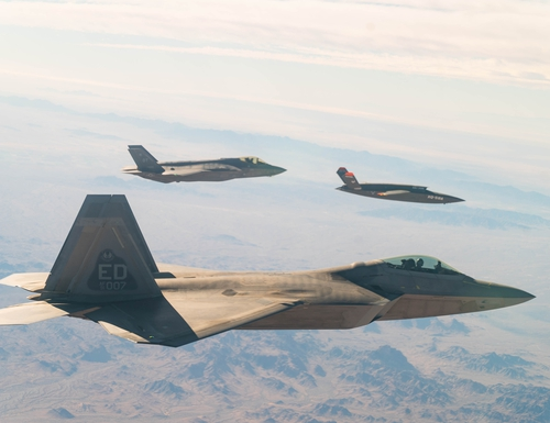 A U.S. Air Force F-22 Raptor and F-35A Lightning II fly in formation with the XQ-58A Valkyrie drone over Yuma Proving Ground in Arizona during a series of tests Dec. 9, 2020. This integrated test follows a series of gatewayONE ground tests that began during the inaugural Air Force on-ramp in December 2019. (Tech. Sgt. James Cason/U.S. Air Force)