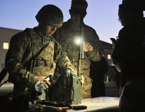 Pfc. Andrew Lebron of C Company, 1st Battalion, 501st Aviation Regiment, Combat Aviation Brigade, 1st Armored Division works with a radio as part of the CAB's Soldier of the Quarter competition. (Pvt. Matthew J. Marcellus/U.S. Army)