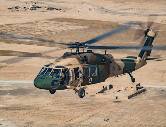 An Afghan Air Force UH-60 Blackhawk piloted by an Afghan and American pilot fly in formation Dec. 8, 2018, while participating in the NATO led Resolute Support mission in Afghanistan. (Staff Sgt. Clayton Cupit/ U.S. Air Force)