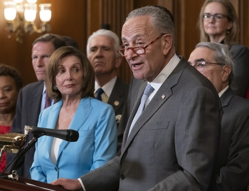Speaker of the House Nancy Pelosi, D-Calif., left, listens to remarks by Senate Minority Leader Chuck Schumer, D-N.Y., at an event before a House vote on the SAFE Act (Securing America's Federal Elections Act) which aims to protect the integrity of elections from outside interference, at the Capitol in Washington, Wednesday, June 26, 2019. (AP Photo/J. Scott Applewhite)