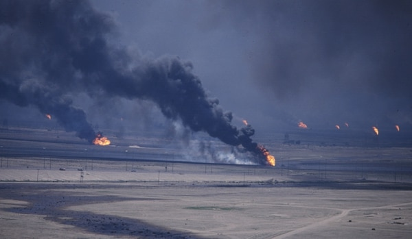 FILE - In this March 2, 1991 file photo, Kuwait's oil wells burn after the defeated Iraqi troops were expelled from Kuwait. The oil-rich, tiny country of Kuwait is still shaped by the 1991 Gulf War. Twenty-five years later, there is a freely elected parliament in place but problems persist and many fear Kuwait could be gripped by the same regional tensions at play across the greater Middle East. (AP Photo, File)