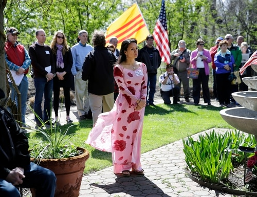 Kim Lan Duong, of Dallas, Texas, wears a traditional Vietnamese dress during ceremonies commemorating the 40th anniversary of Operation Babylift from Vietnam Friday, April 24, 2015, in Holmdel, N.J. Kim Lan Duong was a three-year-old when she was airlifted from Vietnam in Operation Babylift. (AP Photo/Mel Evans)