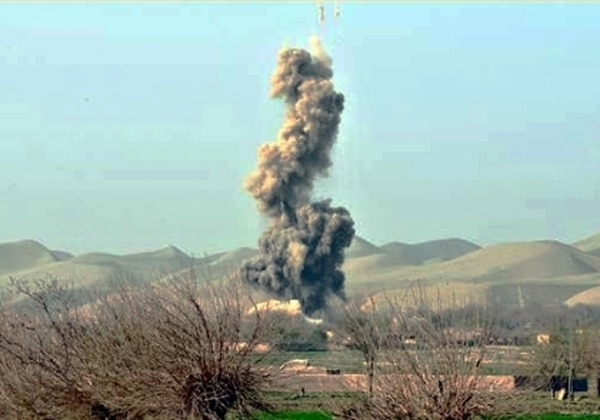 An insurgent compound explodes after a Air Force B-1 Lancer drops a 38GBU bomb on it in northern Bala Murghab Valley, Badghis province, Afghanistan, on April 4, 2011. Military planners always try to balance the protection of civilians with military necessity, such as protecting troops in contact with the enemy. (Air Force)