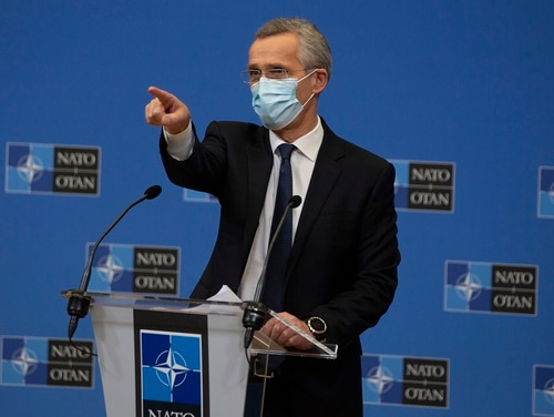 NATO Secretary General Jens Stoltenberg wears a protective face mask as he prepares to speak during a media conference at NATO headquarters in Brussels on Feb. 18, 2021. (Virginia Mayo/Pool via AP)
