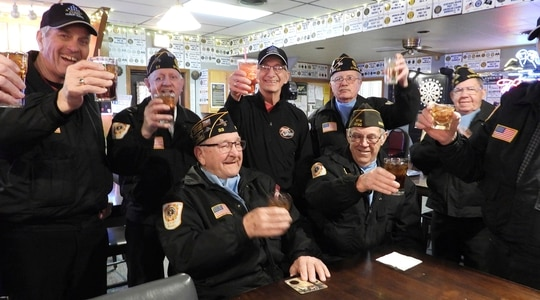 Fellow members of the Sturgis Honor Guard raise a glasses to Arvid Meland, left, who completed his 3,000th honor guard service on Monday, March 2, 2020. (Deb Holland/Black Hills Pioneer via AP)