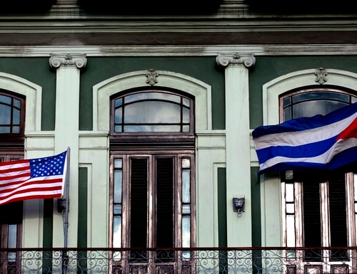 A Cuban and U.S. flag wave from the balcony of the Hotel Saratoga where a U.S. Congressional delegation is staying in Havana, Cuba, Monday, Jan. 19, 2015. Cuba's foreign minister told the group of U.S. senators and congressmen Monday that his country is open to greater diplomatic and trade ties but the congressional delegation did not meet President Raul Castro, the man who will make many of the key decisions about the new U.S.-Cuban relationship. (AP Photo/Ramon Espinosa)