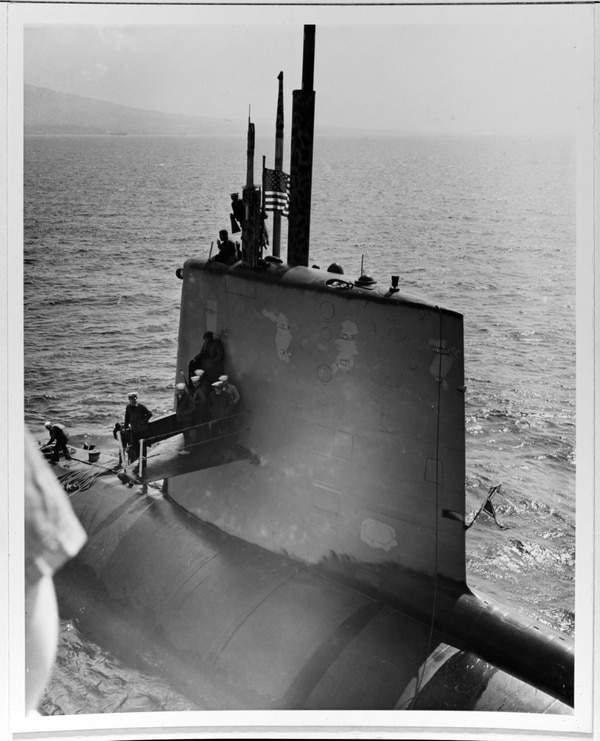 The submarine Scorpion comes alongside the tank landing ship Tallahatchie County outside Claywall Harbor, Naples, on April 10, 1968. The submarine's Commanding Officer, Cmdr. Francis A. Slattery, is atop her sail, holding a megaphone. (Courtesy Lt. John R. Holland, Engineering Officer, Tallahatchie County, 1969, now in the collections of U.S. Naval History and Heritage Command)