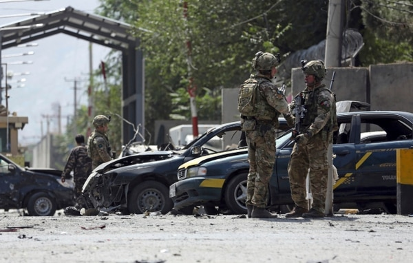 Resolute Support forces inspect the site of a car bomb explosion in Kabul, Afghanistan, Sept. 5, 2019. A car bomb rocked the Afghan capital on Thursday and smoke rose from a part of eastern Kabul near a neighborhood housing the U.S. Embassy, the NATO Resolute Support mission and other diplomatic missions. (Rahmat Gul/AP)