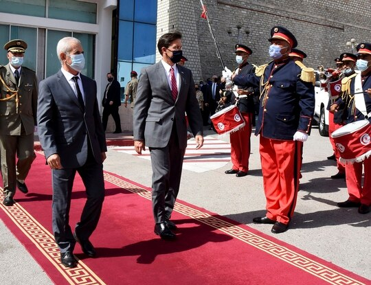 Tunisian Defense Minister Brahim Bartagi, left, welcomes U.S. Secretary of Defense Mark Esper in Tunis on Wednesday, Sept. 30, 2020. (Hassene Dridi/AP)