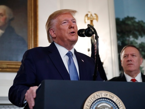 President Donald Trump, accompanied by Secretary of State Mike Pompeo, speaks about the latest Turkey/Syria cease-fire agreement from in the Diplomatic Room of the White House on Oct 23, 2019. (Jacquelyn Martin/AP)