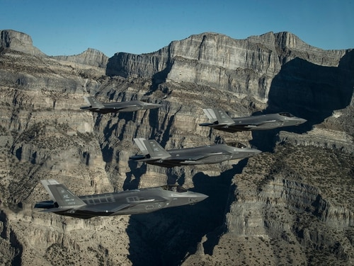 A formation of U.S. Air Force F-35 Lightning IIs assigned to the 388th and 419th Fighter Wings stationed at Hill Air Force Base perform aerial maneuvers during as part of a combat power exercise over Utah Test and Training Range, Nov. 19, 2018. (Staff Sgt. Cory D. Payne/Air Force)