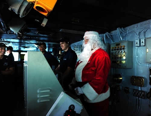 Santa's got the helm in this 2013 photo aboard the aircraft carrier Theodore Roosevelt. (Navy)