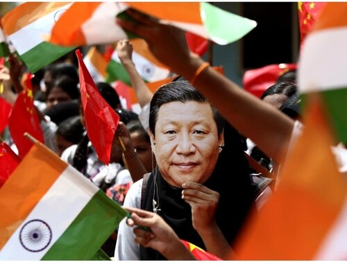 An Indian schoolgirl wears a face mask of Chinese President Xi Jinping to welcome him on the eve of his visit in Chennai, India, Thursday. (R. Parthibhan/AP)