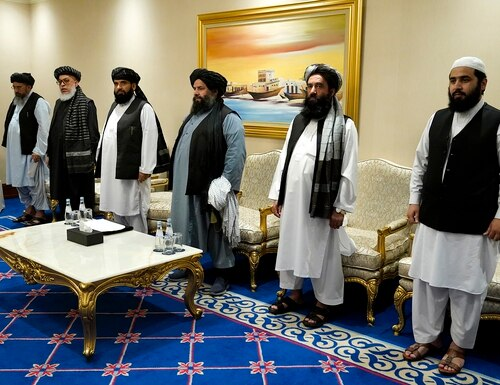 Members of the Taliban's peace negotiation team meet with Secretary of State Mike Pompeo amid talks between the Taliban and the Afghan government, Saturday, Nov. 21, 2020, in Doha, Qatar. (Patrick Semansky/Pool via AP)