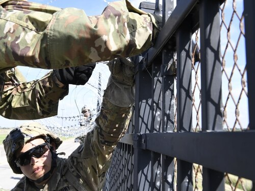 Soldiers from engineering units install concertina wire Nov. 5, 2018, on the Anzalduas International Bridge, Texas. U.S Northern Command is providing military support to the Department of Homeland Security and U.S. Customs and Border Protection to secure the southern border of the United States. (Airman First Class Daniel A. Hernandez/Air Force)