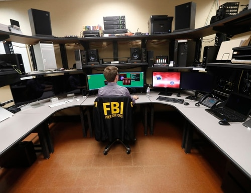 An FBI employee works in a computer forensics lab at the field office in New Orleans. (Gerald Herbert/AP)
