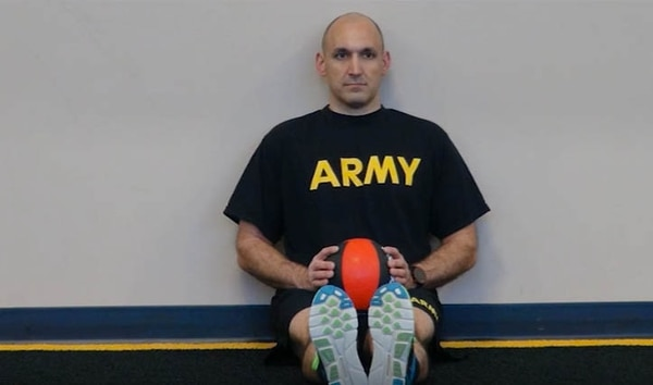 A soldier demonstrates the seated power throw.