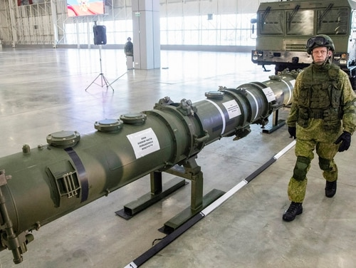 A Russian military officer walks past the 9M729 land-based cruise missile on display with its launcher, right, in Kubinka outside Moscow on Jan. 23, 2019. (Pavel Golovkin/AP)