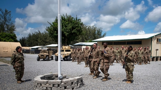 A flag-raising ceremony is held Aug. 26, 2019, at Camp Simba, Manda Bay, Kenya. (Staff Sgt. Lexie West/U.S. Air Force via AP)